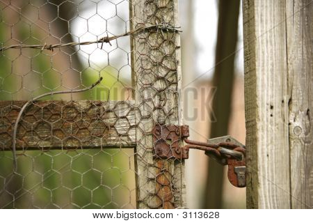 Old Lock Secures A Garden Fence