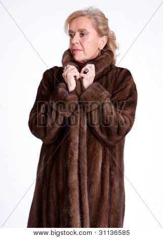 Senior lady wearing a mink coat