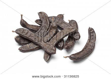 Dried Carob pods on white background