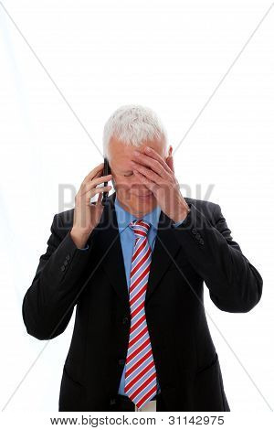 Businessman Disappointed Calling With Hand On Forehead
