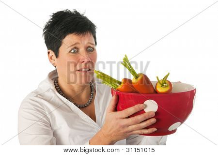 Young woman weird with big cup and carrots