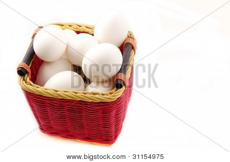 White Eggs On A Basket Isolated