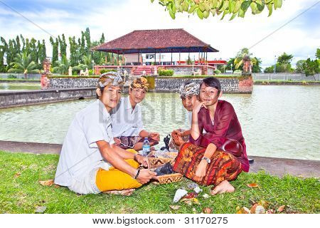 LOMBOK- FEBRUARY 1: Young Hindu people in front  remains of the Water Palace built in 1744 to serve the Balinese court of justice, part of the Royal Palace Mayura February 1, 2012. Lombok, Indonesia.