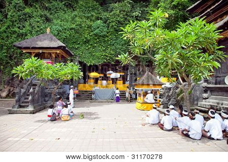 PURA GOA LAWAH, BALI, INDONESIA :JANUARY 25: People praying at holy cave temple Pura Lawah during the Nyegara Gunung ceremony on January 25, 2012 in Padangbai,  Bali, Indonesia