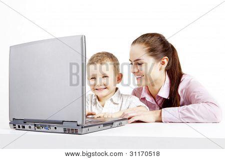 boy, laptop and woman