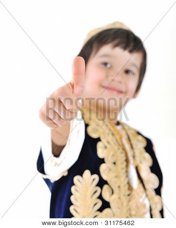 Little kid wearing european traditional clothes with thumbs up