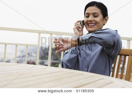 Woman checking the time on her watch