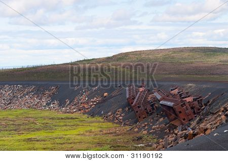 Derailed railroad cars trucks