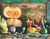 Assortment Of Various Autumn Vegetables For Healthy Cooking On Cupboard poster
