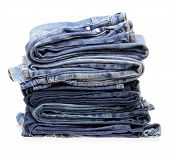 stock photo of hackney  - stack of blue denim clothes on white background - JPG