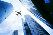 Airplane Flying Over Business Skyscrapers. Business And Transport, Transportation, Travel Concept. B poster