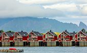 Red Norwegian Fishing Houses Rorbu At Pier In Svolvaer, Lototen Islands, Austvagoya, Vagan Municipal poster