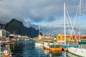 Yachts And Boats With Mountain In The Background At Pier In Svolvaer, Lototen Islands, Austvagoya, V poster