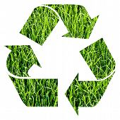 stock photo of reprocess  - recycle symbol obtained cutting out photographic green grass - JPG