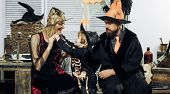 Children Play With Witch Mother. Parents And Child Dressed In Halloween Witch Costumes. Happy Hallow poster