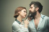 Woman Hairdresser Cuts Beard With Scissors. Man With Long Beard, Mustache And Stylish Hair, Light Ba poster