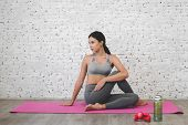 Sport Woman Sitting Relax On Pink Mat And Do Fitness Exercise With Water Bottle At Home.diet Concept poster