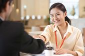 Portrait Young Asian Woman Interviewer And Interviewee Shaking Hands For A Job Interview .business P poster