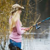 pic of fisherwomen  - beautiful blond girl in pink sweater fishing - JPG