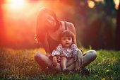 Mother And Daughter Having Fun In The Park. Happy Family Concept. Beauty Nature Scene With Family Ou poster