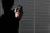 Man Hand Aim A Gun Isolated On Black Window,  Personal Defense Or Theft And Robbery Concept poster