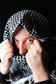 stock photo of fundamentalist  - man in Keffiyeh looking at camera  - JPG