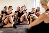 Teacher And Group Of Children Exercising Dancing And Ballet In Dance School poster