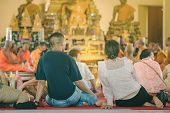 Buddhist Ordination Ceremony In The Church Of Buddhist Temple In Thailand poster