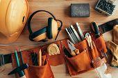 Professional Handyman Tool Belt On The Desk In Workshop poster