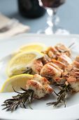 picture of souvlaki  - Chicken souvlaki on rosemary branches with lemon - JPG