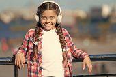 Enjoying Her Favorite Music. Little Girl Wearing Stereo Headphones. Little Girl Listening To Music.  poster