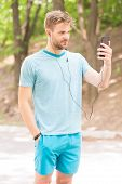 Phone Designed For Achieving Fitness Goals. Sportsman Making Video Call From Mobile Phone Outdoor. A poster