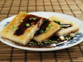 picture of taro corms  - Taro cakes are a common dim sum dish in Chinese culture - JPG