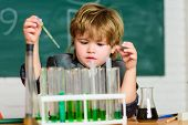 Chemical Analysis. Science Concept. Wunderkind Experimenting With Chemistry. Boy Use Microscope Test poster