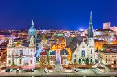 Harrisburg, Pennsylvania, USA nighttime cityscape with historic churches. poster