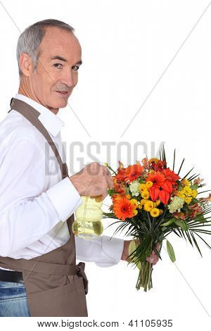 Florist spraying flowers