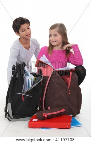 Children with schoolbags
