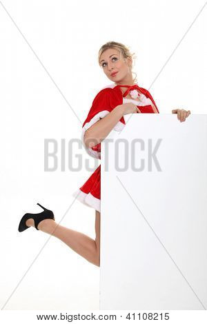sexy lady Christmas holding a white panel