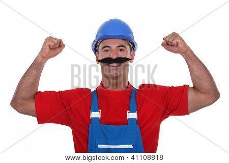 Muscular tradesman wearing a fake moustache