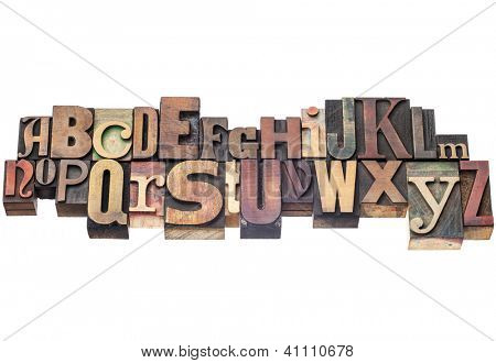 English alphabet abstract in antique wood letterpress printing blocks of different sizes and styles, isolated on white