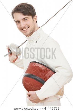Young smiling fencer in protective sport wear with rapier foil and mask isolated