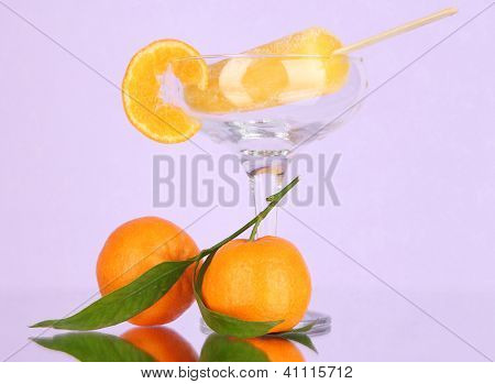 Yellow fruit juice ice in vase on purple background