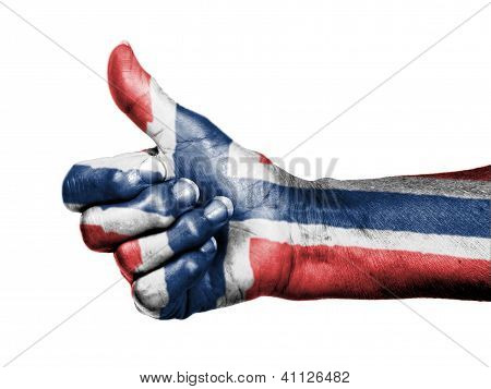 Old Woman With Arthritis Giving The Thumbs Up Sign, Wrapped In Flag Pattern