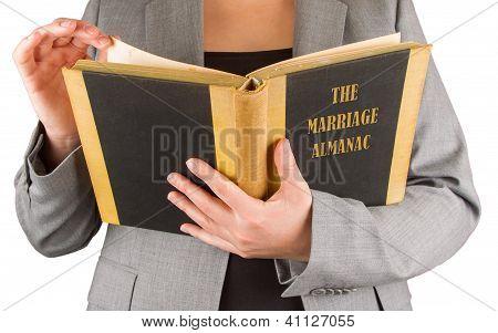 Woman Reading A Marriage Almanac