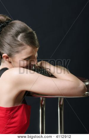 Smiling Girl Leaning On Bar Chair