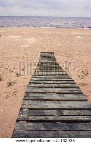 Wooden Track On Baltic Sea Beach In Jurmala