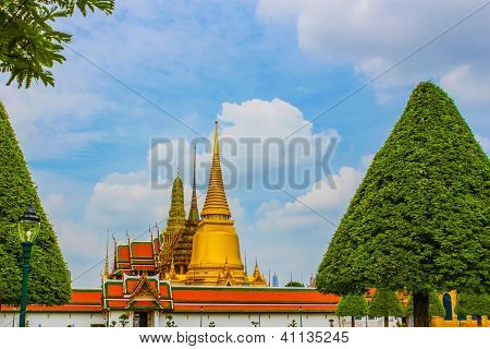 Golden Castle under Blue Sky and in the Green Trees Frame