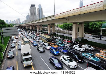 SHANGHAI, CHINA - MAY 30: Traffic jam during rush hours with busy commuters on May 30, 2012 in Shanghai. Shanghai is the largest city by population in the world with 23 million in 2010.