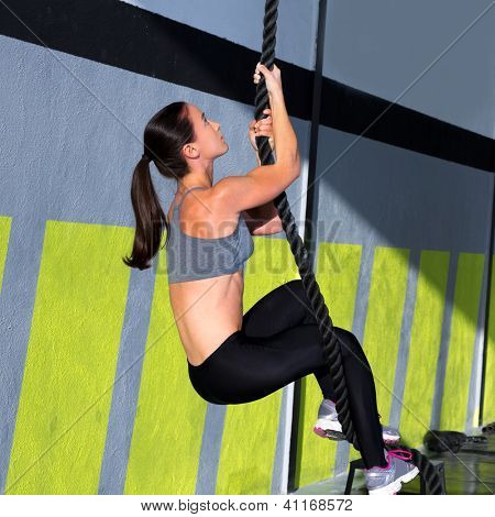 rope climb exercise in fitness gym workout