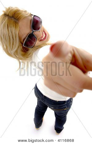 High Angle View Of Smiling Woman Pointing At Camera